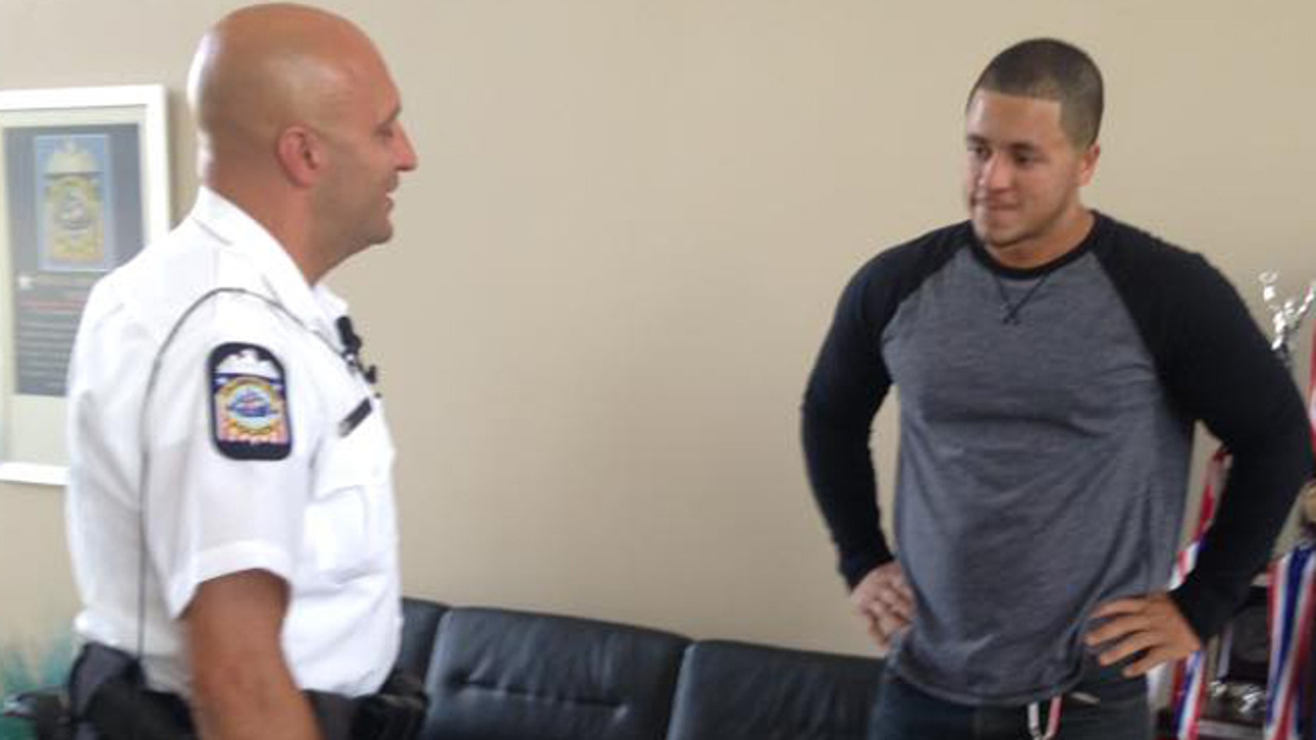 Officer James Poole and Christopher Jones. (Columbus Police Department)