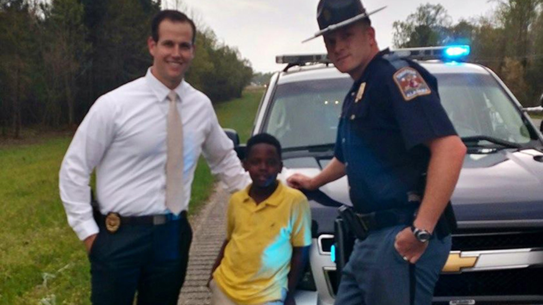 Ala. AG Investigator Eric Salvador, Christopher Wheeler, the young hero,  and Trooper Lee Walls. (ALEA)