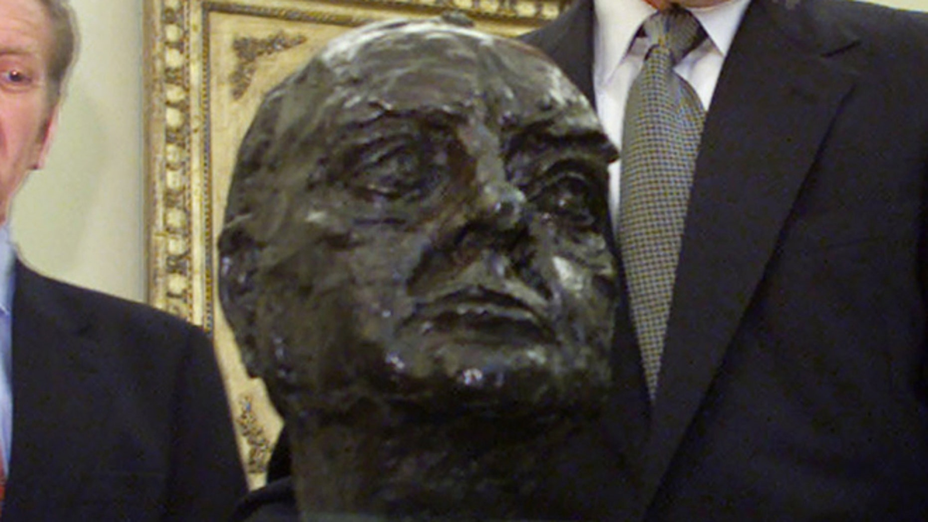 FILE: In this July 16, 2001 photo, a bust of Winston Churchill is seen in the Oval Office of the White House.