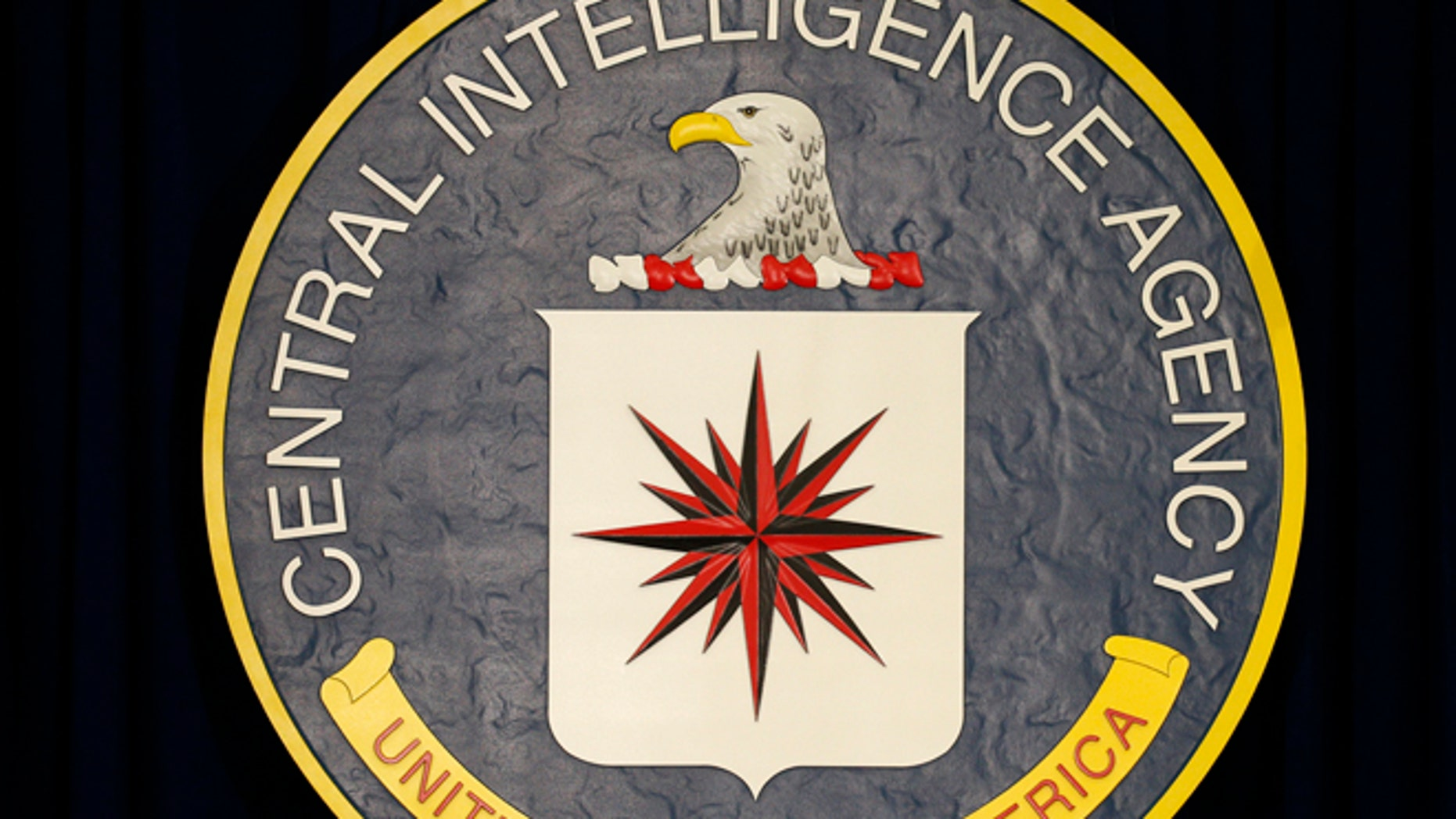 April 13, 2016: The CIA sign is seen onstage before the arrival of U.S. President Barack Obama to speak following a meeting with his National Security Council at CIA Headquarters in Langley, Virginia.