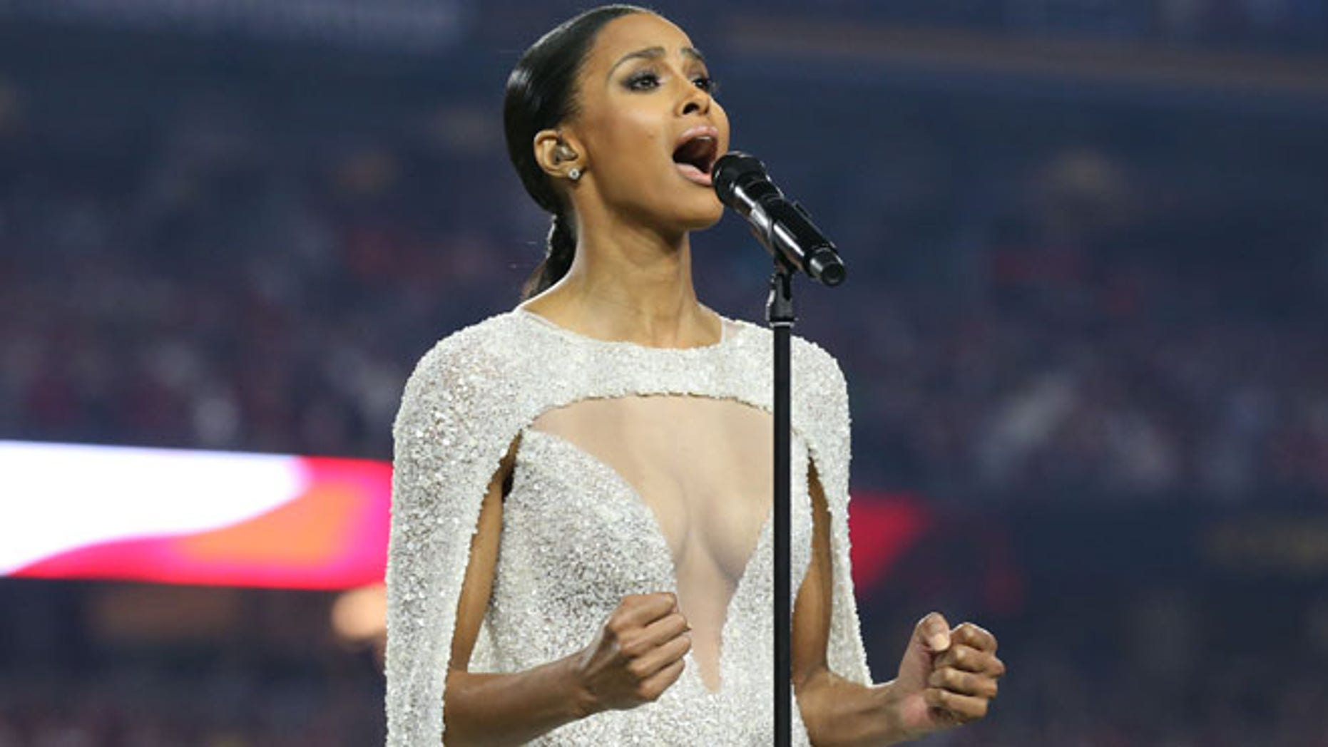 Jan 11, 2016; Glendale, AZ, USA; Recording artist Ciara sign the National Anthem prior to the game between the Alabama Crimson Tide and the Clemson Tigers in the 2016 CFP National Championship at University of Phoenix Stadium. Mandatory Credit: Matthew Emmons-USA TODAY Sports - RTX21XVG