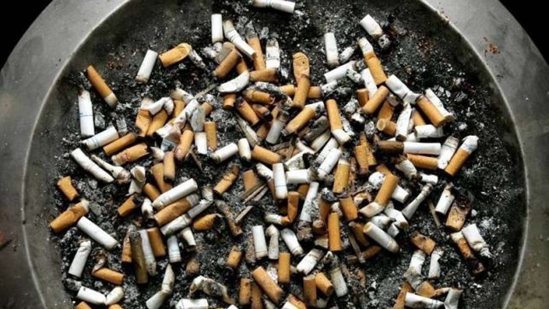 Feb. 21, 2005: Cigarette butts lie in an ashtray outside a Montreal office building.