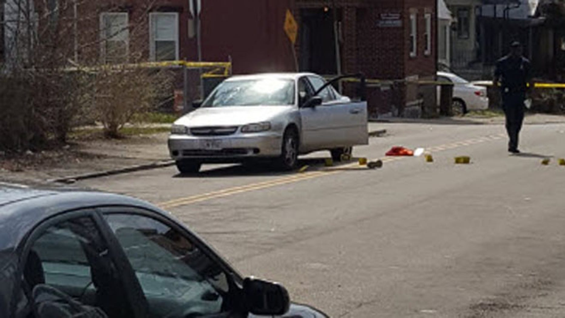 Police investigate after driver was shot and killed after his car hit a 4-year-old boy who ran into the street.