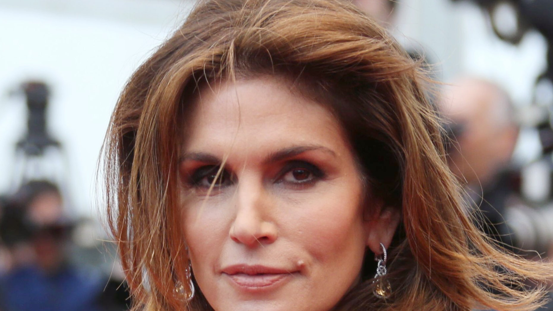 May 15, 2013. Model Cindy Crawford poses on the red carpet at the Cannes Film Festival.