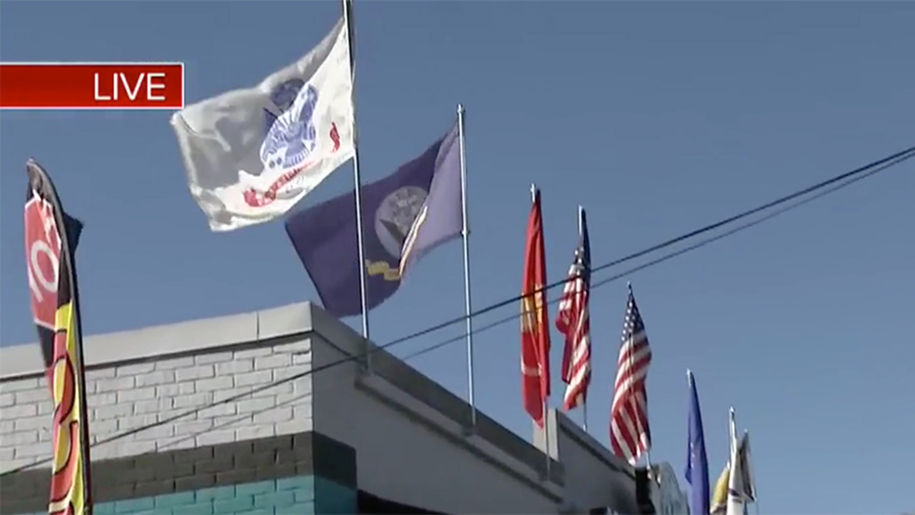 Jaguar Power Sports in Jacksonville, Fla., was cited Monday for flying military flags.