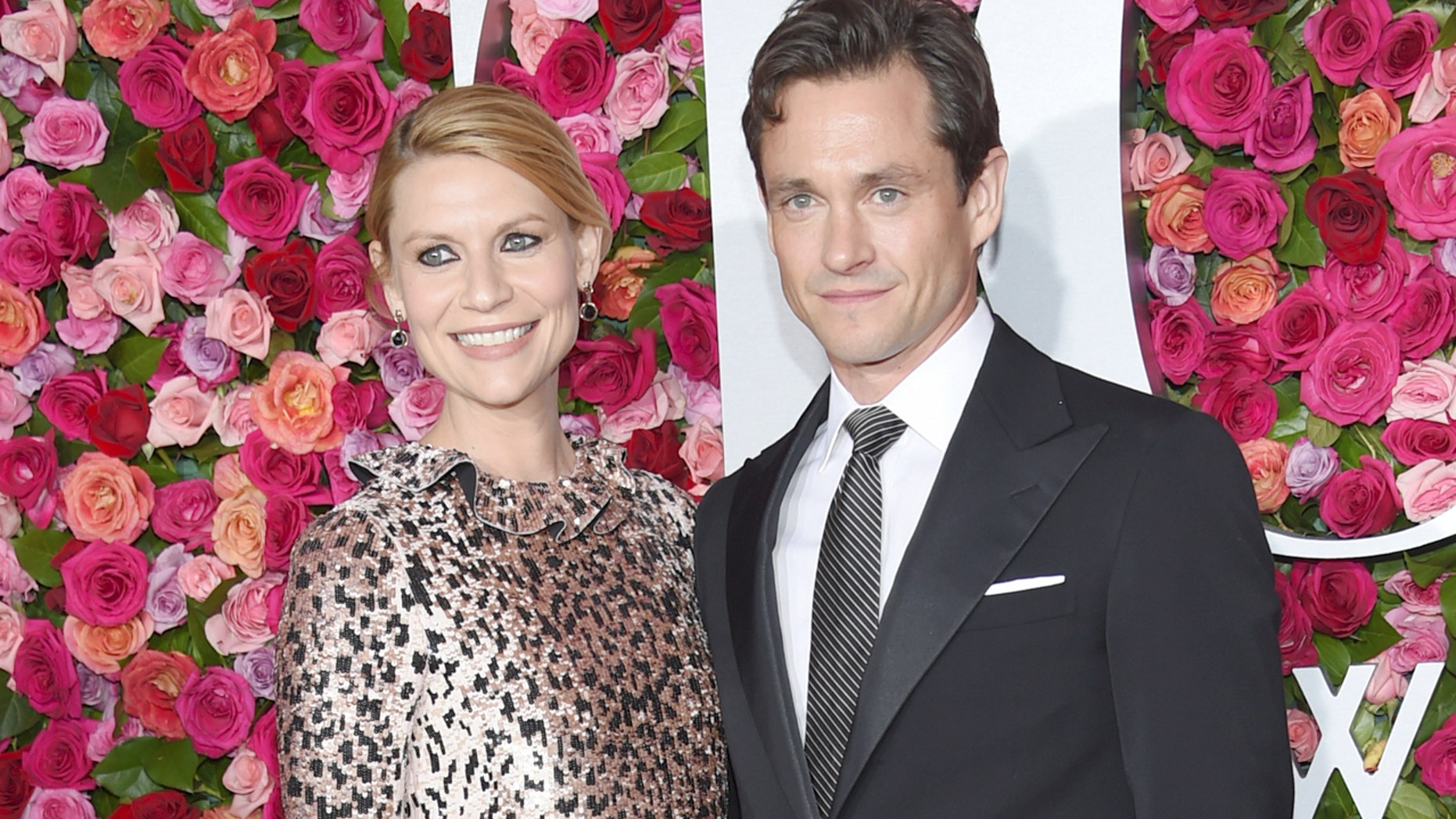 FILE - In this June 10, 2018 file photo, Claire Danes, left, and Hugh Dancy arrive at the 72nd annual Tony Awards in New York. A publicist for the actors said Friday, Aug. 31, that the couple gave birth Monday in New York. (Photo by Evan Agostini/Invision/AP, File)
