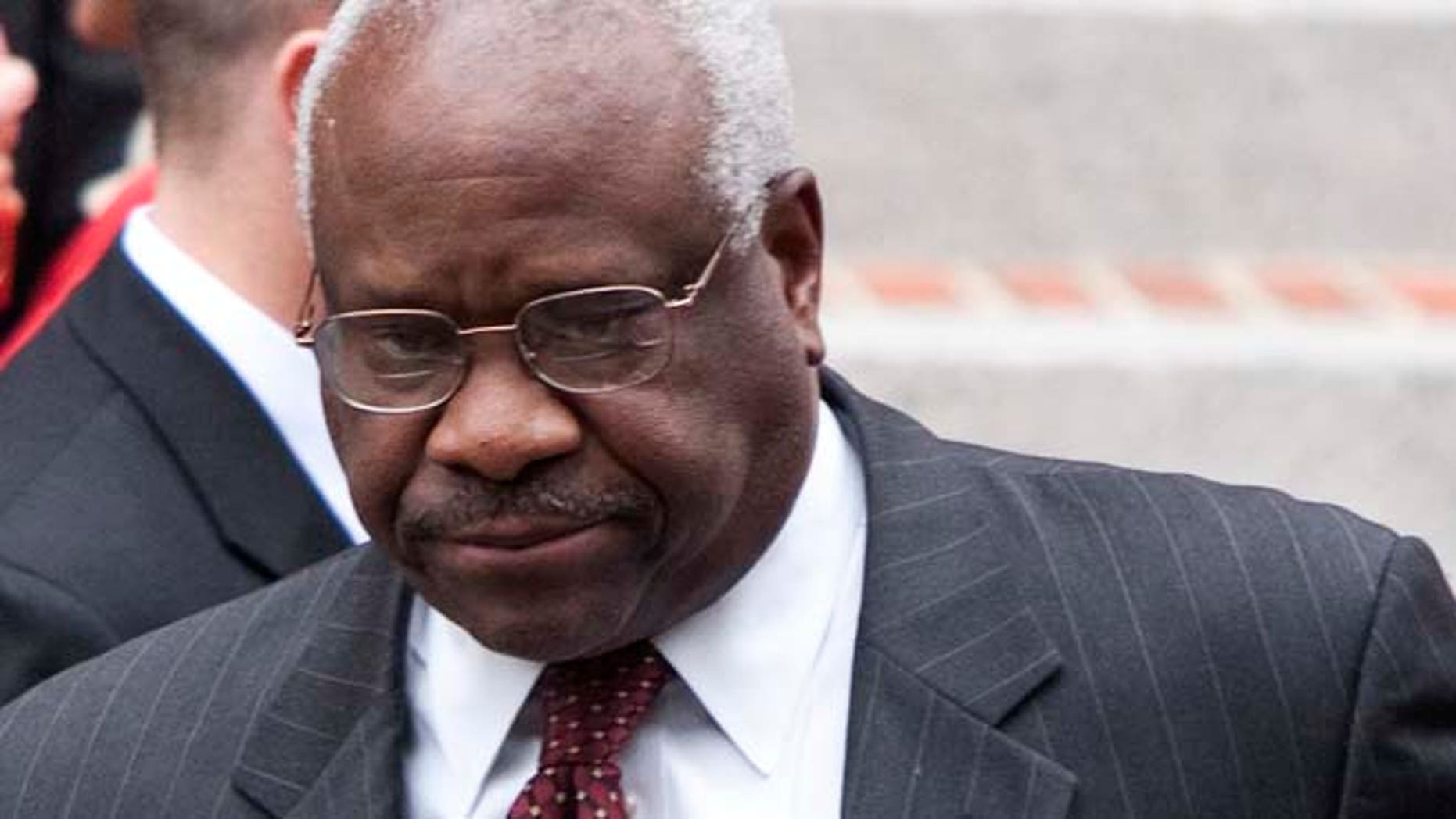 FILE 2011: A standardized-test textbook publisher apologized Tuesday for a graphic in a European History booklet that lumped Supreme Court Justice Clarence Thomas with the KKK.