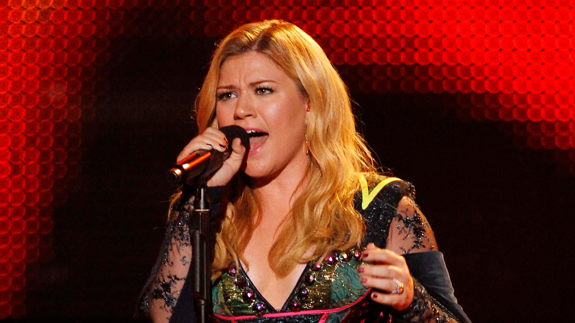 December 16, 2012. Kelly Clarkson performs at the VH1 Divas 2012 show in Los Angeles.