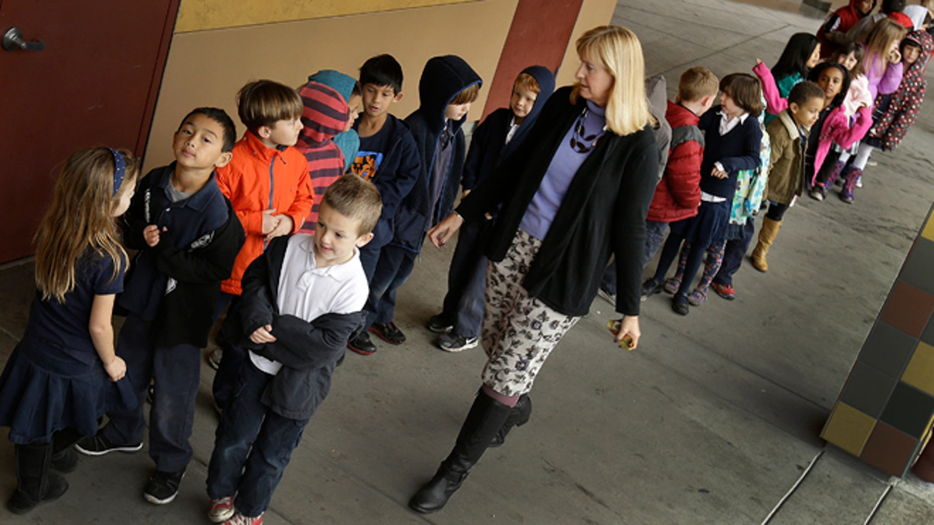 Jan. 24, 2013: First grade teacher Lynda Jensen walks her class of 30 children at the Willow Glenn Elementary School in San Jose, Calif.