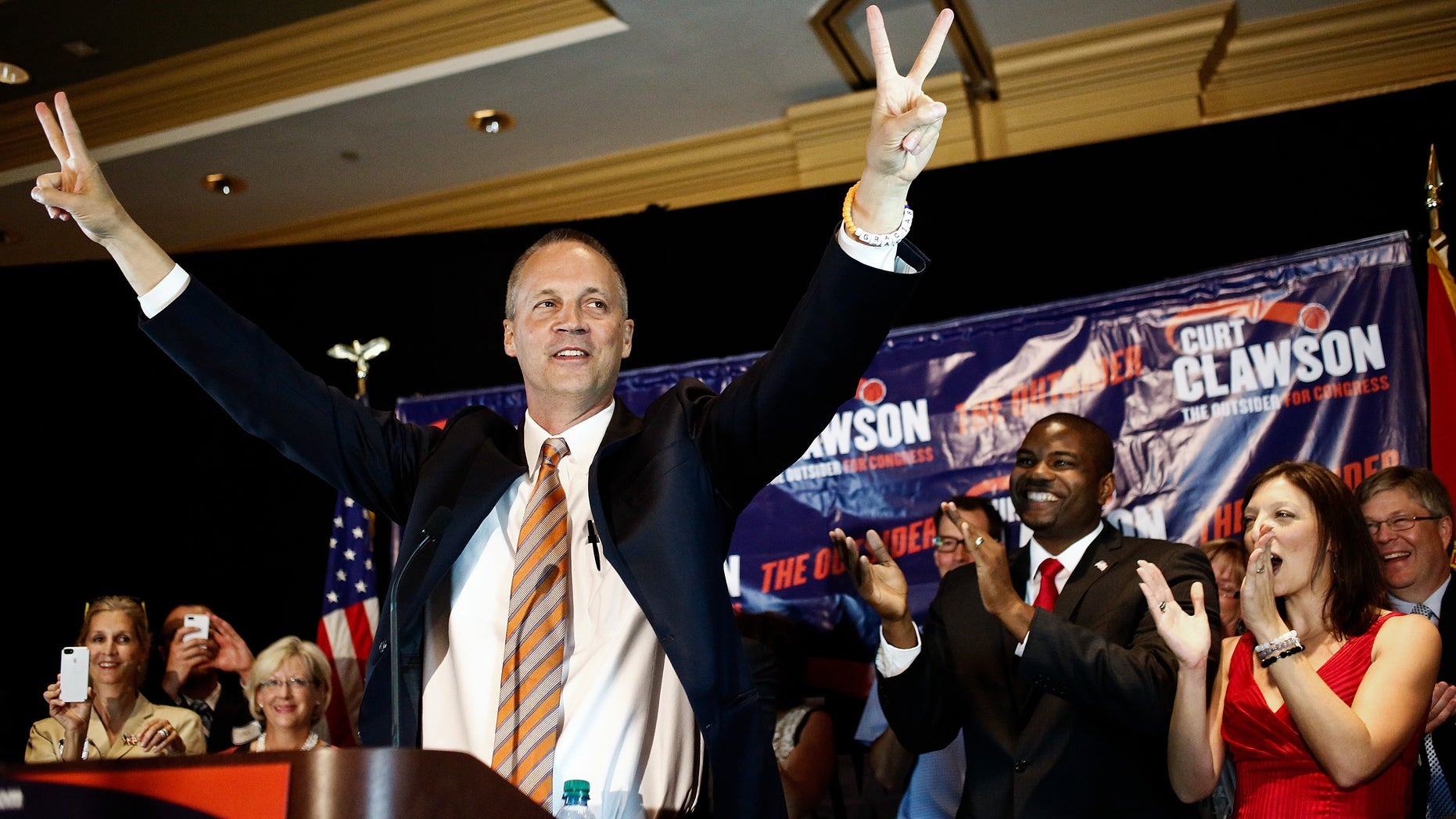 April 22, 2014: Curt Clawson celebrates along with a cheering crowd at his election party at the Hyatt Regency Coconut Point in Bonita Springs, Fla.