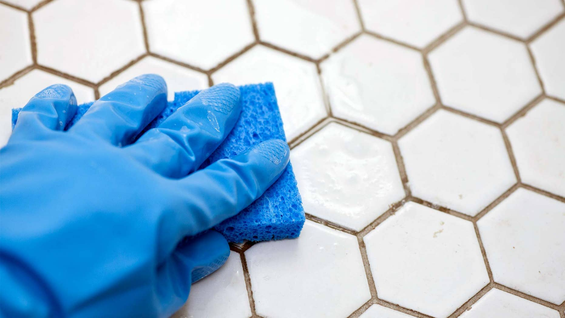 cleaning grout with sponge