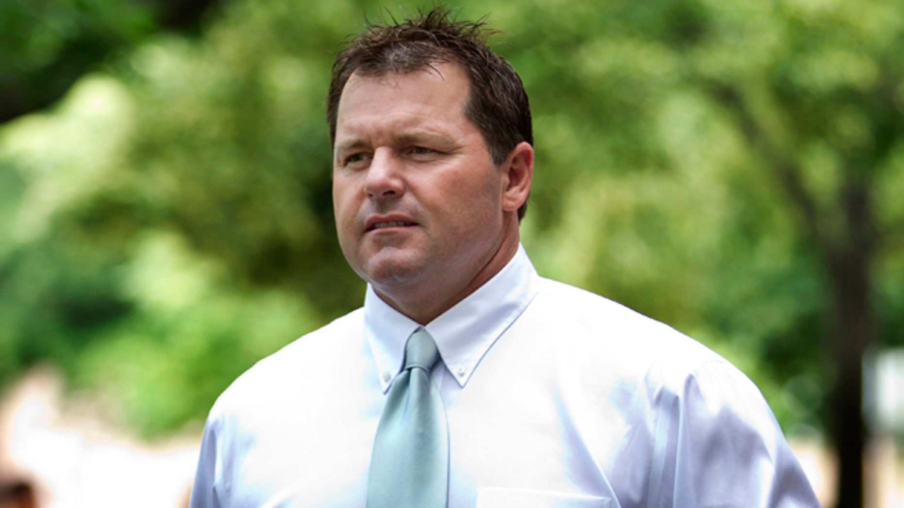 May 23, 2012: Former Major League Baseball pitcher Roger Clemens arrives at federal court in Washington.