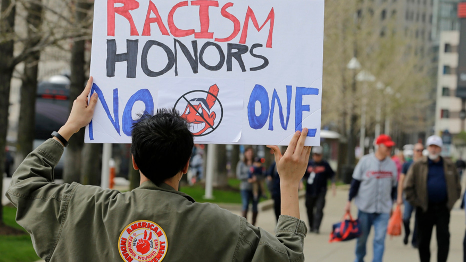 April 11, 2017: Josh Hunt protests as fans walk to the ballpark before a baseball game between the Chicago White Sox and the Cleveland Indians during opening day in Cleveland. Hunt is from the Cheyenne and Arapaho Tribe.