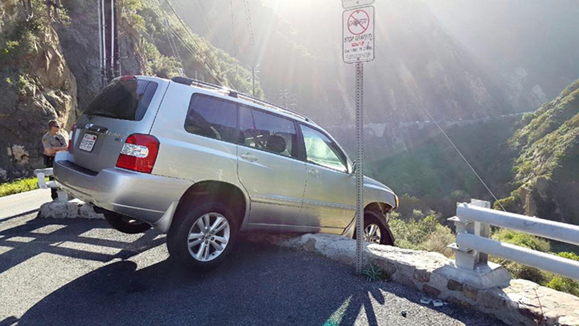 An SUV that broke through a guardrail in Malibu.