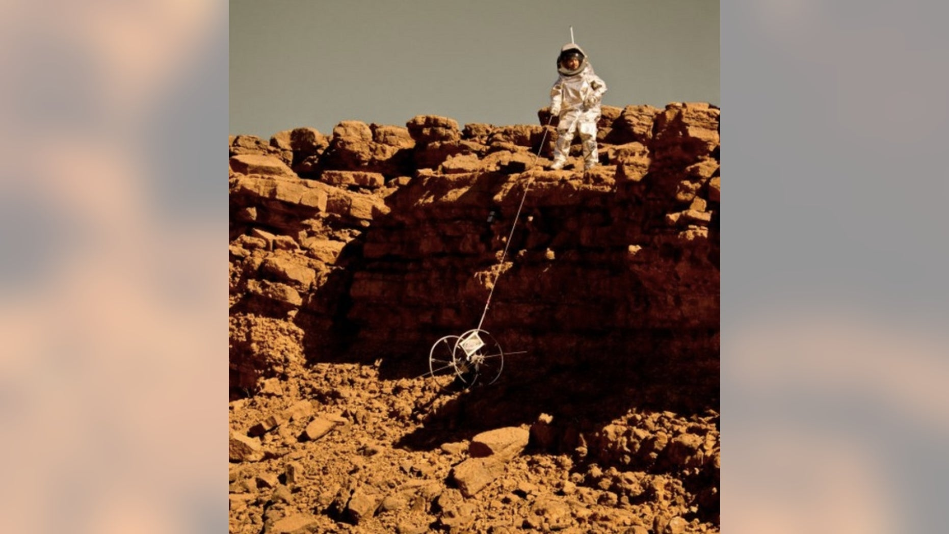 A 'Cliffbot' is lowered over some rocks during a field test in Morocco in 2013.