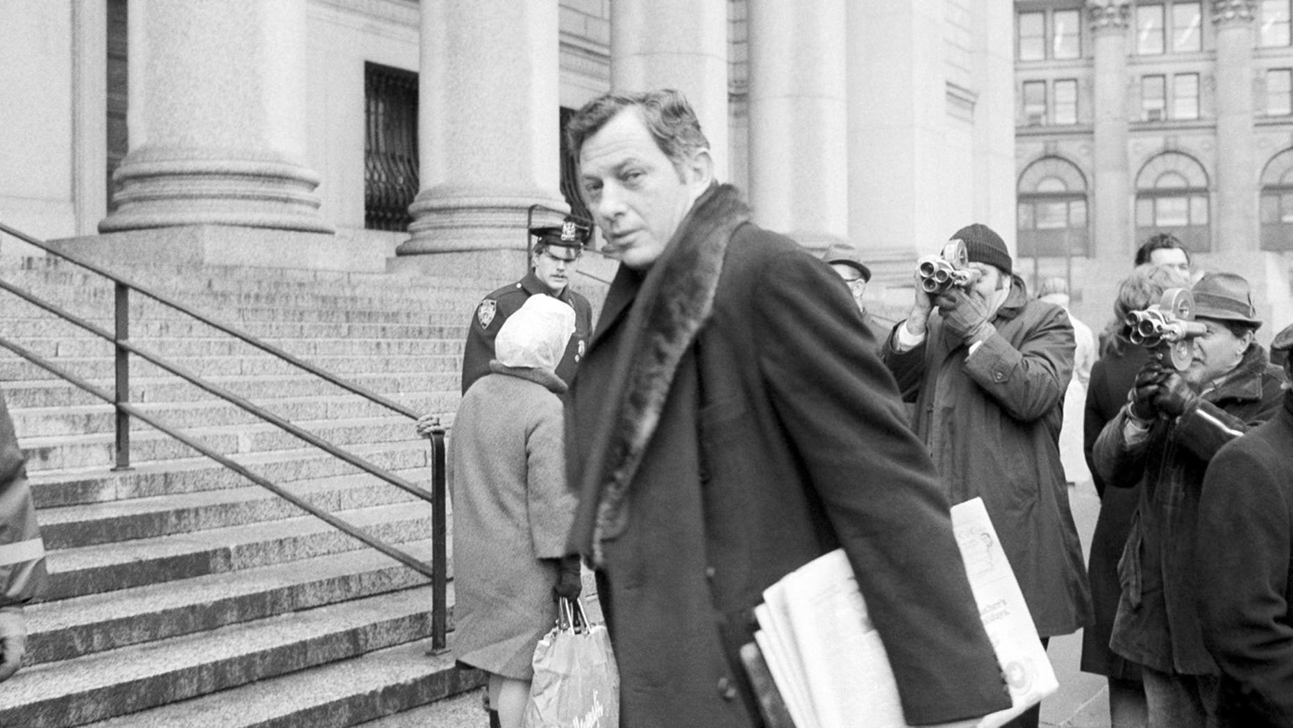 Clifford Irving enters a federal courthouse in New York City, March 13, 1972.