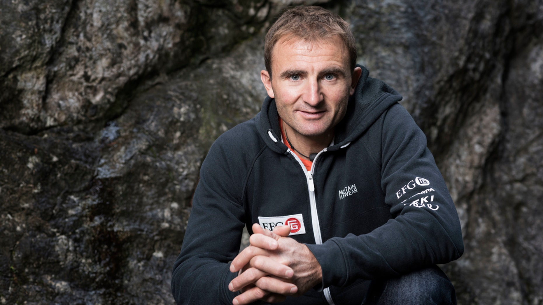 In this Sept. 11, 2015 file photo Swiss climber Ueli Steck poses for a photo at the foot of a climbing wall in Wilderswil, Canton of Berne, Switzerland.