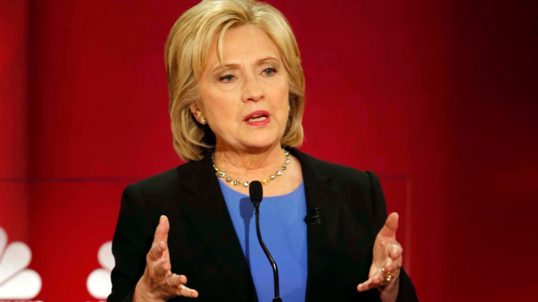 Democratic presidential candidate, Hillary Clinton speaks at the NBC, YouTube Democratic presidential debate at the Gaillard Center, Sunday, Jan. 17, 2016, in Charleston, S.C. (AP Photo/Mic Smith)