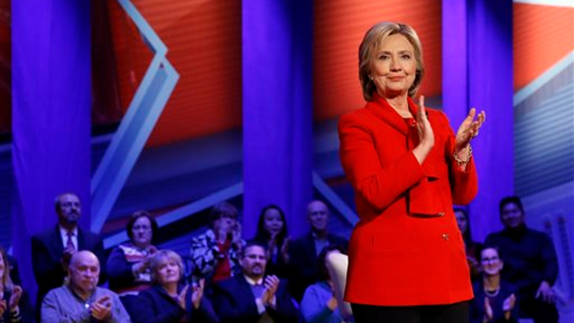 Democratic presidential candidate Hillary Clinton applauds after a CNN town hall at Drake University in Des Moines, Iowa, Monday, Jan. 25, 2016. (AP Photo/Patrick Semansky)