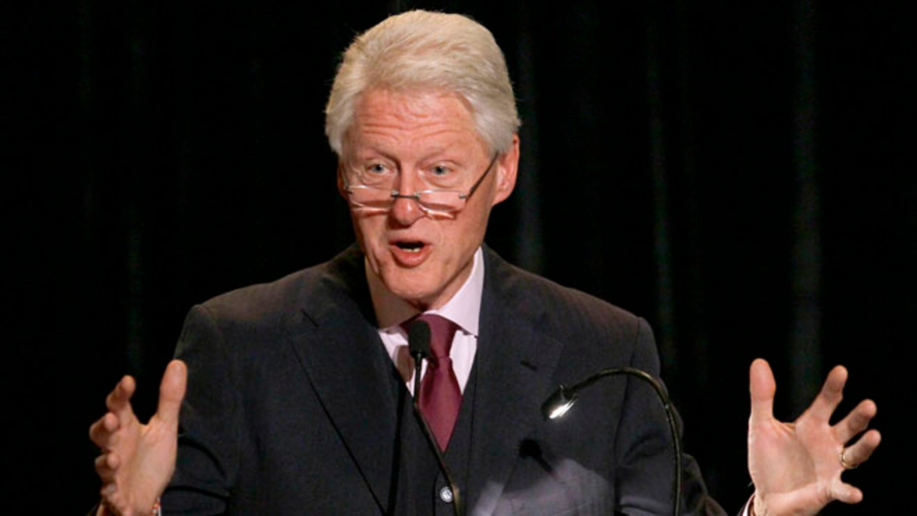 April 23, 2012: Former President Bill Clinton addresses the audience during the opening night dinner of the World Summit of Nobel Peace Laureates at the Field Museum.
