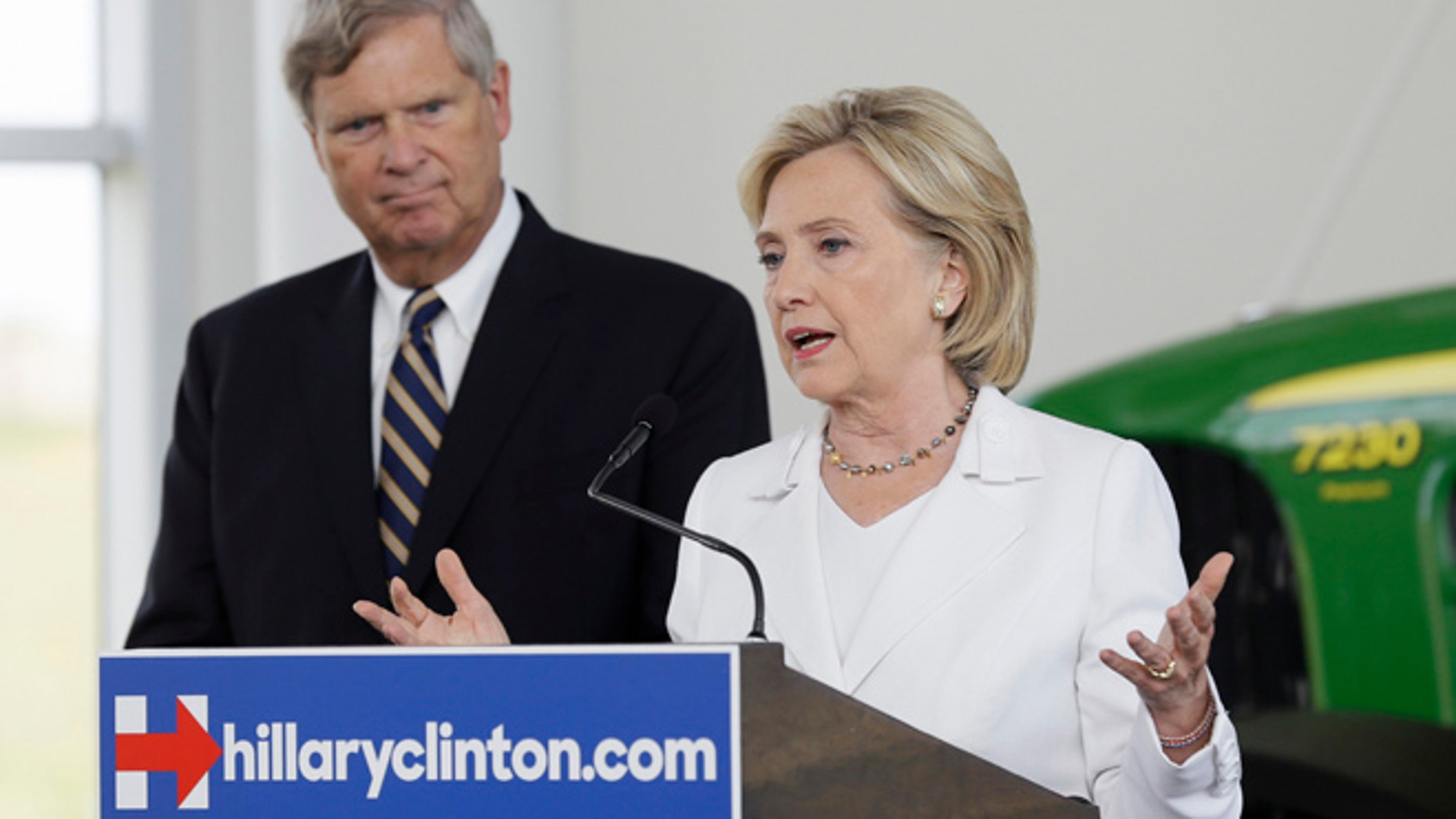 Aug 26, 2015: Democratic presidential candidate Hillary Rodham Clinton, accompanied by Agriculture Secretary Tom Vilsack, speaks during a news conference at the Des Moines Area Community College in Ankeny, Iowa. (AP)