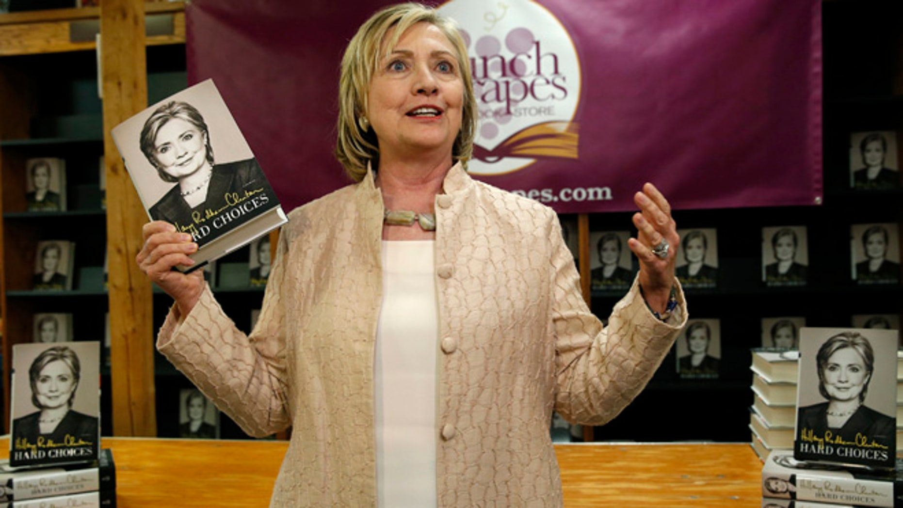 """Aug 13, 2014: Hillary Clinton arrives for a signing session for her book """"Hard Choices"""" at the Bunch of Grapes bookstore in Vineyard Haven on Martha's Vineyard, Massachusetts. (Reuters)"""
