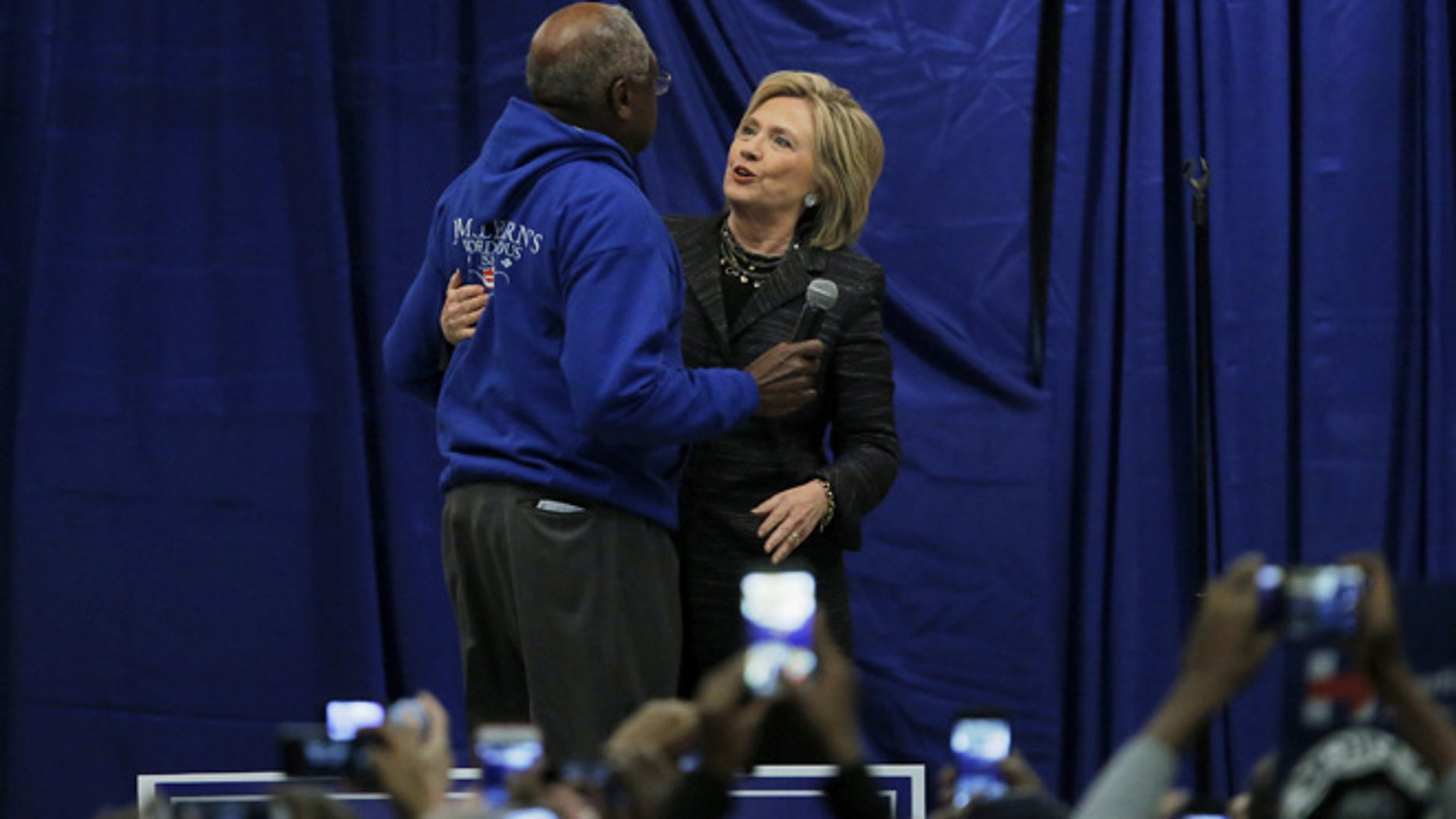 U.S. Democratic presidential candidate Hillary Clinton shares a hug with U.S. Representative Jim Clyburn on stage during Jim Clyburn's Annual Fish Fry in Charleston, South Carolina January 16, 2016. REUTERS/Chris Keane - RTX22PQY