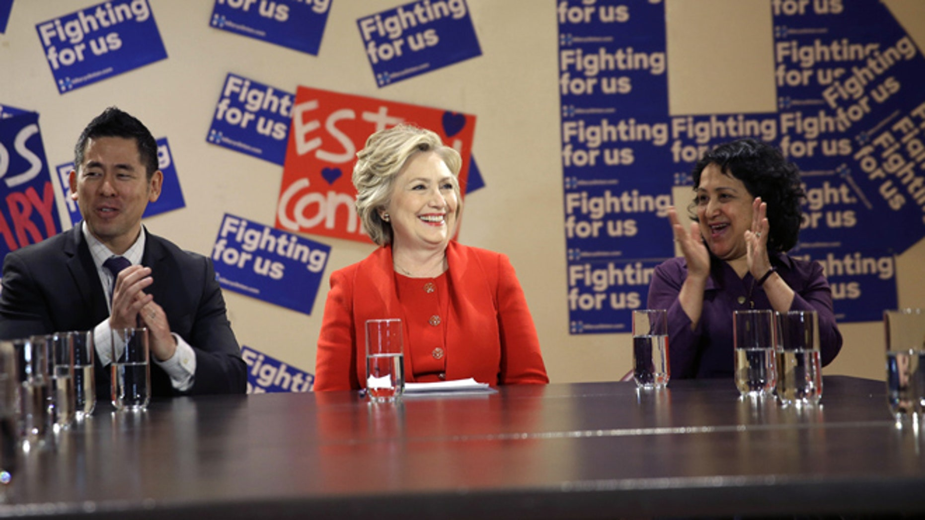 April 13, 2016: Democratic presidential candidate Hillary Clinton talks with local politicians and immigrant activists in New York.