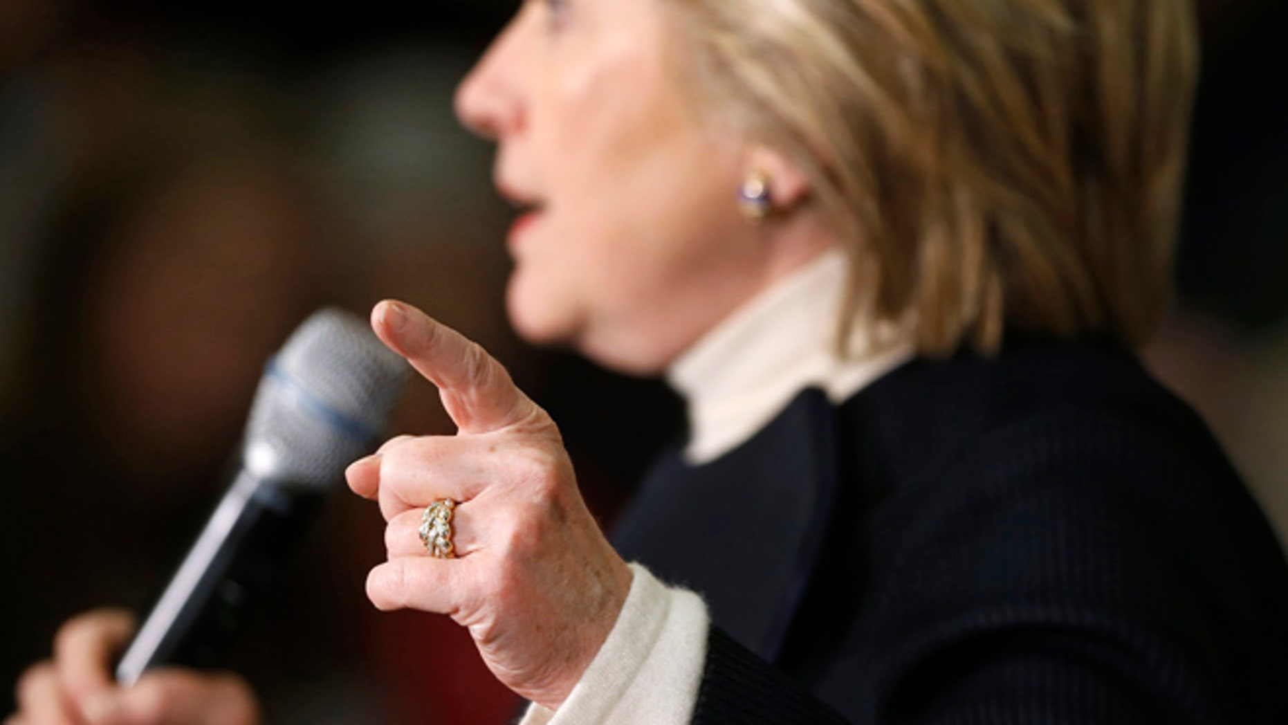 Jan. 18, 2015: Democratic presidential candidate Hillary Clinton gestures as she speaks at a town hall at the Toledo Civic Center in Toledo, Iowa.
