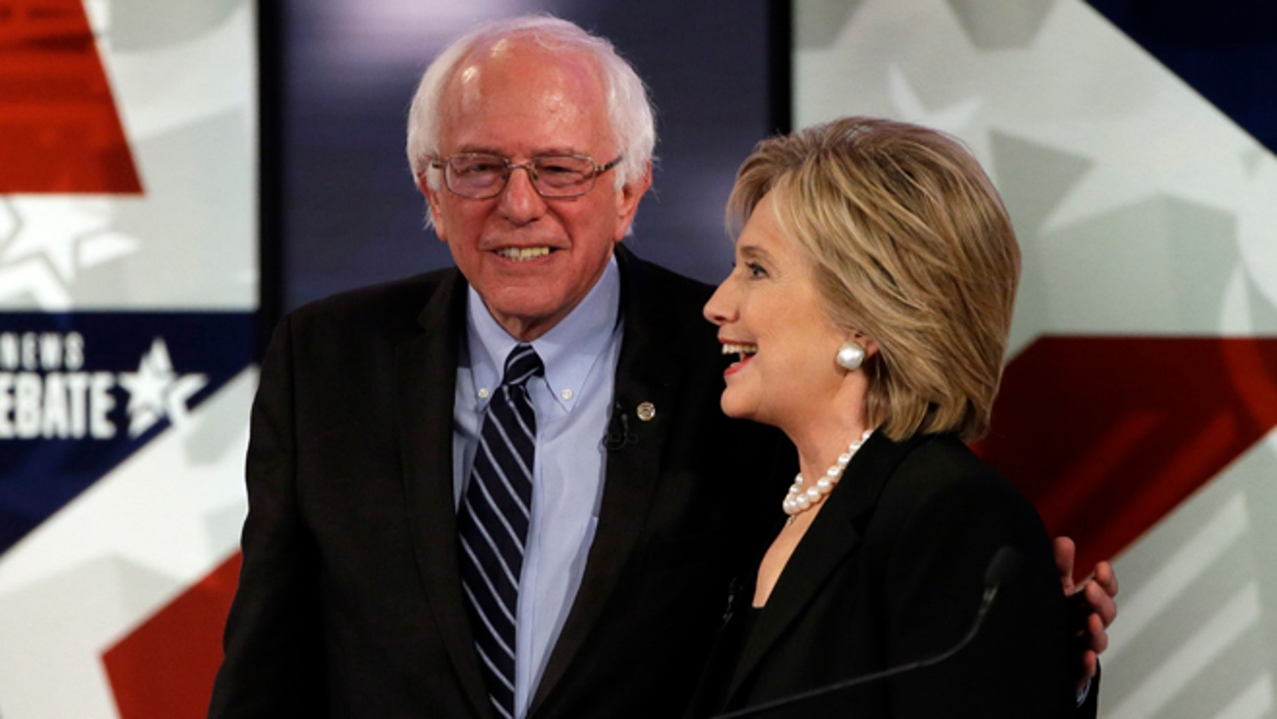 Nov. 14, 2015: Hillary Rodham Clinton, right, talks to Bernie Sanders after a Democratic presidential primary debate in Des Moines, Iowa.
