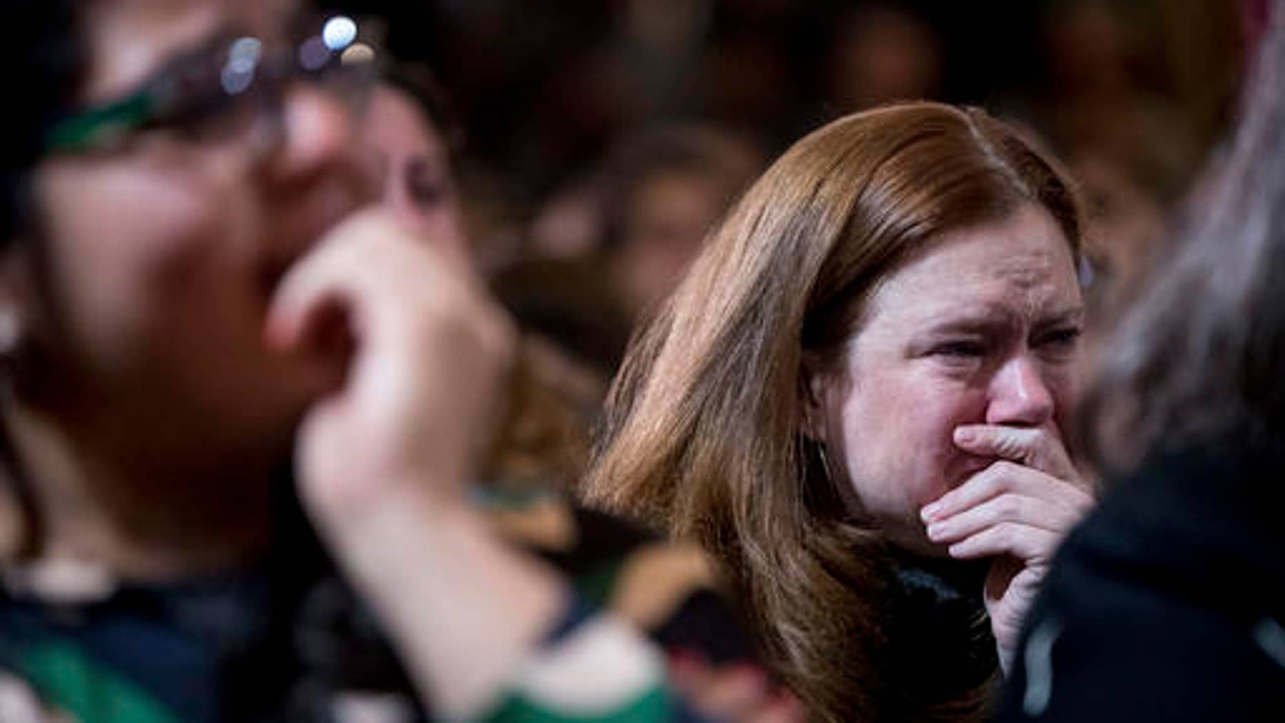 FILE - Staff and supporters listen as Democratic presidential candidate Hillary Clinton speaks at the New Yorker Hotel in New York, Wednesday, Nov. 9, 2016, where she conceded her defeat to Republican Donald Trump after the hard-fought presidential election.