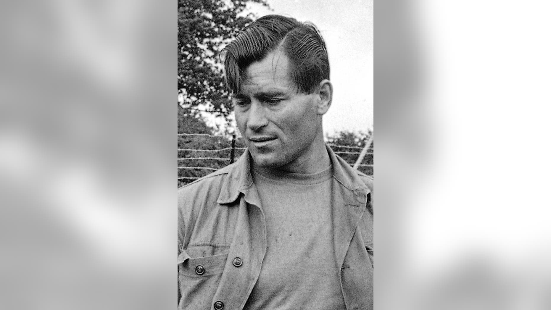 """FILE - In this Aug. 5, 1966 file photo, actor Clint Walker appears on the set of """"The Dirty Dozen"""" in Morkyate, Bedfordshire, England. Walker, who played the title character in the early TV western """"Cheyenne,"""" died Monday, May 21, 2018, of congestive heart failure at a hospital in Grass Valley, Calif. He was 91. (AP Photo, File)"""