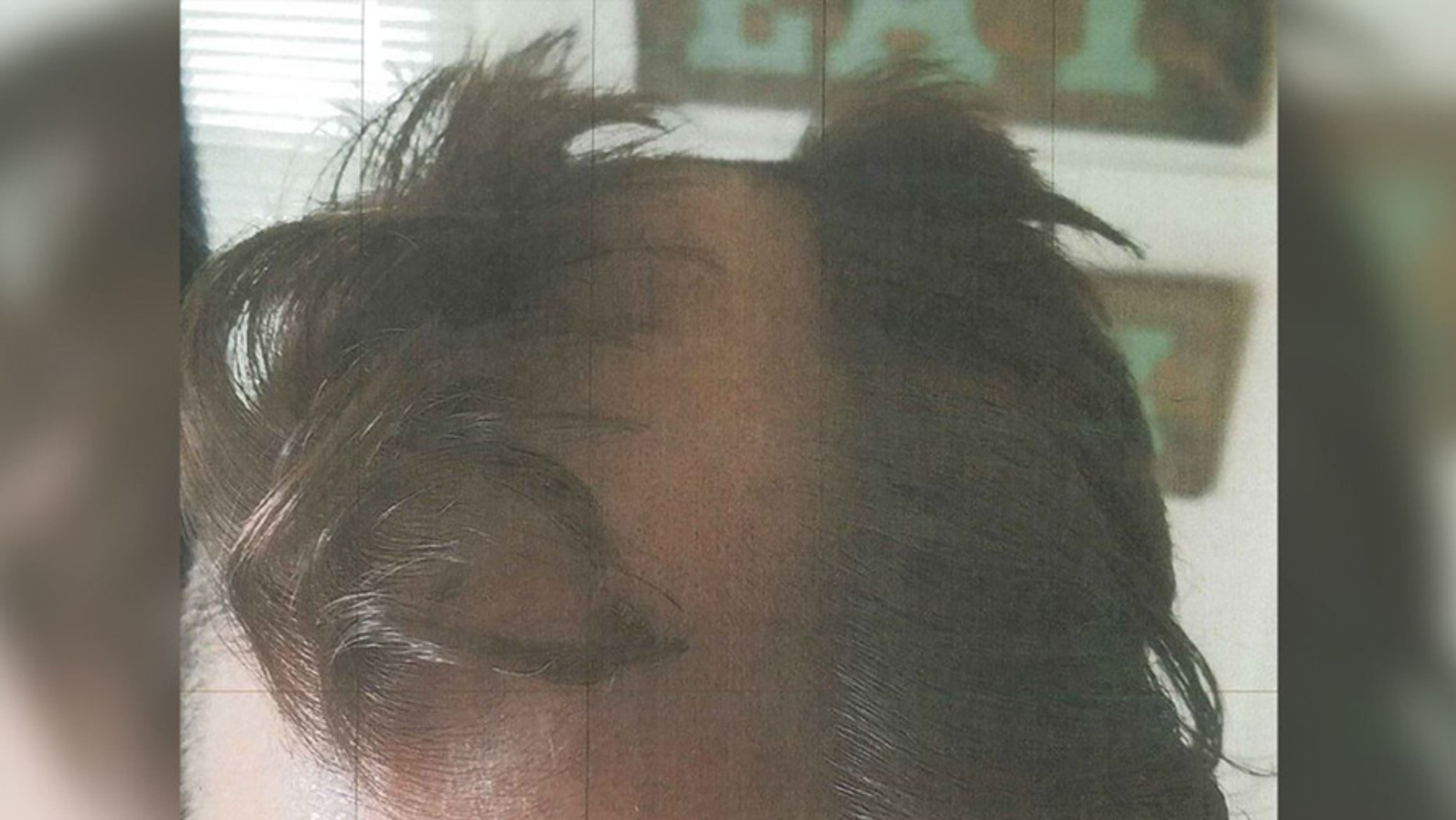 This bad haircut and a wounded ear have left a Wisconsin hairstylist under arrest, authorities said. (Madison Police Department)