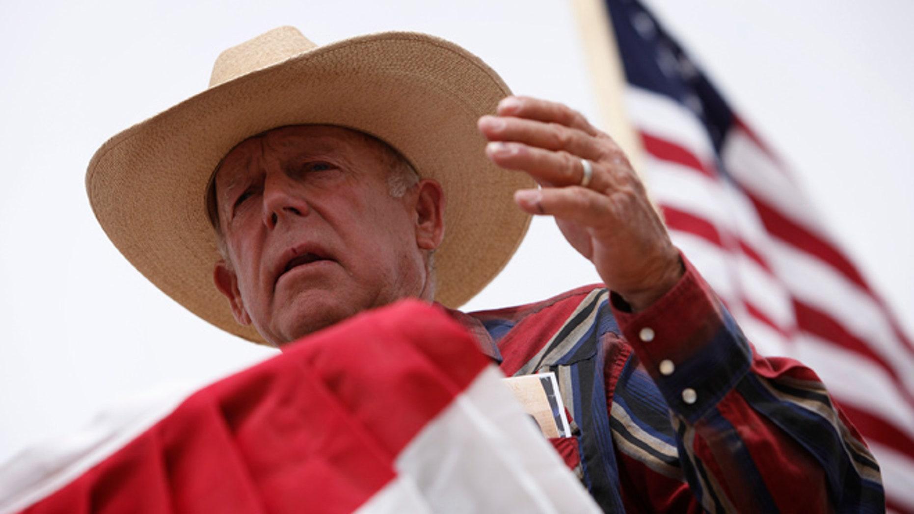 April 18, 2014: Rancher Cliven Bundy speaks at a protest camp near Bunkerville, Nev.