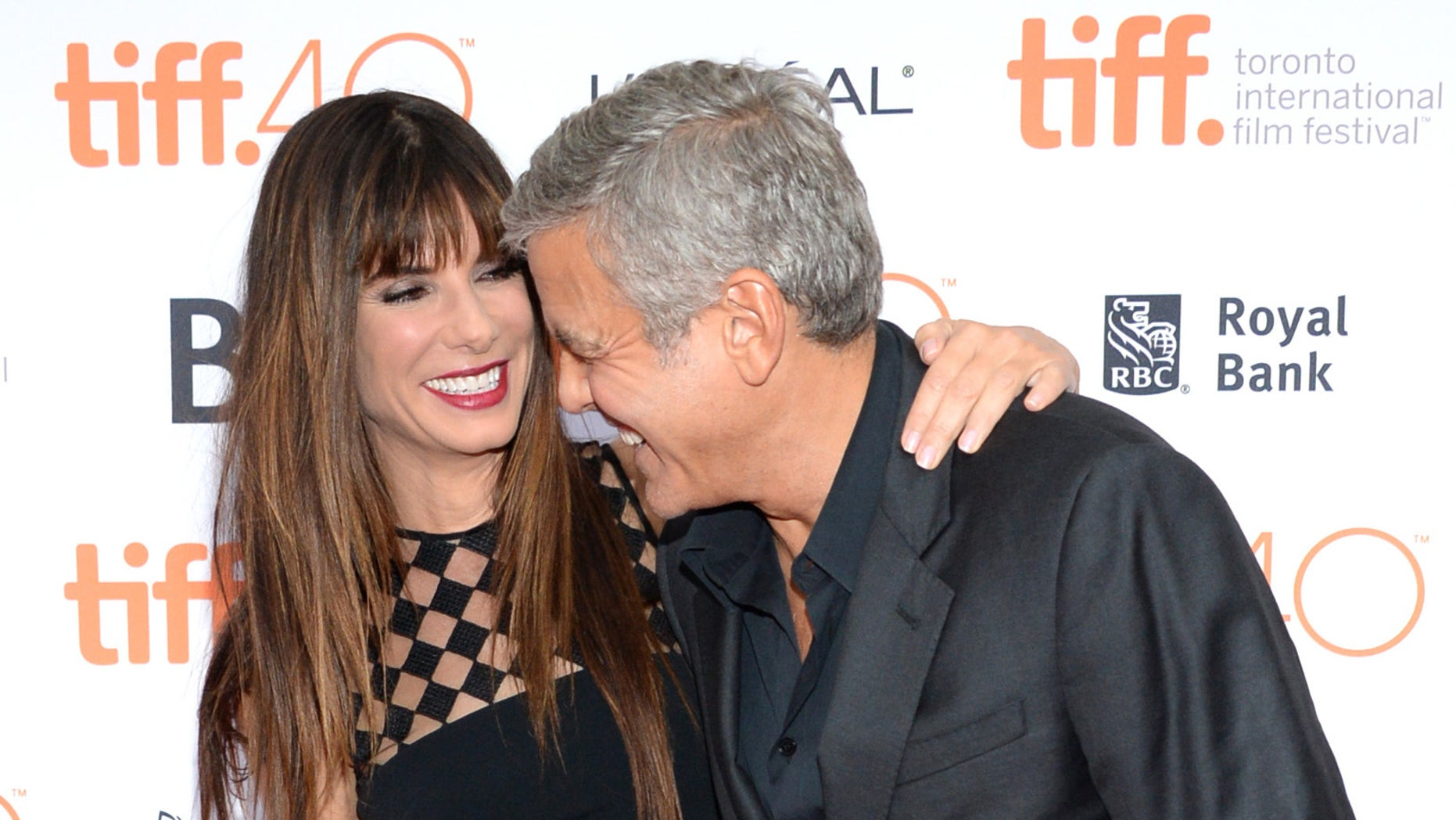 "September 11, 2015. Sandra Bullock, left, and George Clooney attend a premiere for ""Our Brand is Crisis"" on day 2 of the Toronto International Film Festival at the Princess of Wales theatre in Toronto."