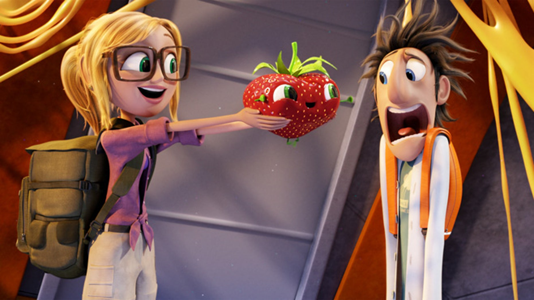 "This film image released by Sony Pictures Animation shows characters, from left, Sam Sparks, voiced by Anna Faris, Barry the Strawberry, voiced by Cody Cameron, and Flint Lockwood, voiced by Bill Hader in a scene from ""Cloudy with a Chance of Meatballs."""