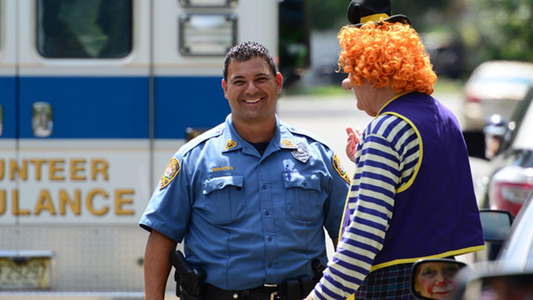 """July 29, 2014: Westwood Police Officer Niko Pieratos talks speaks with Jack """"Poppi T Clown"""" Erbstein in Westwood, N.J. following a minor traffic accident."""