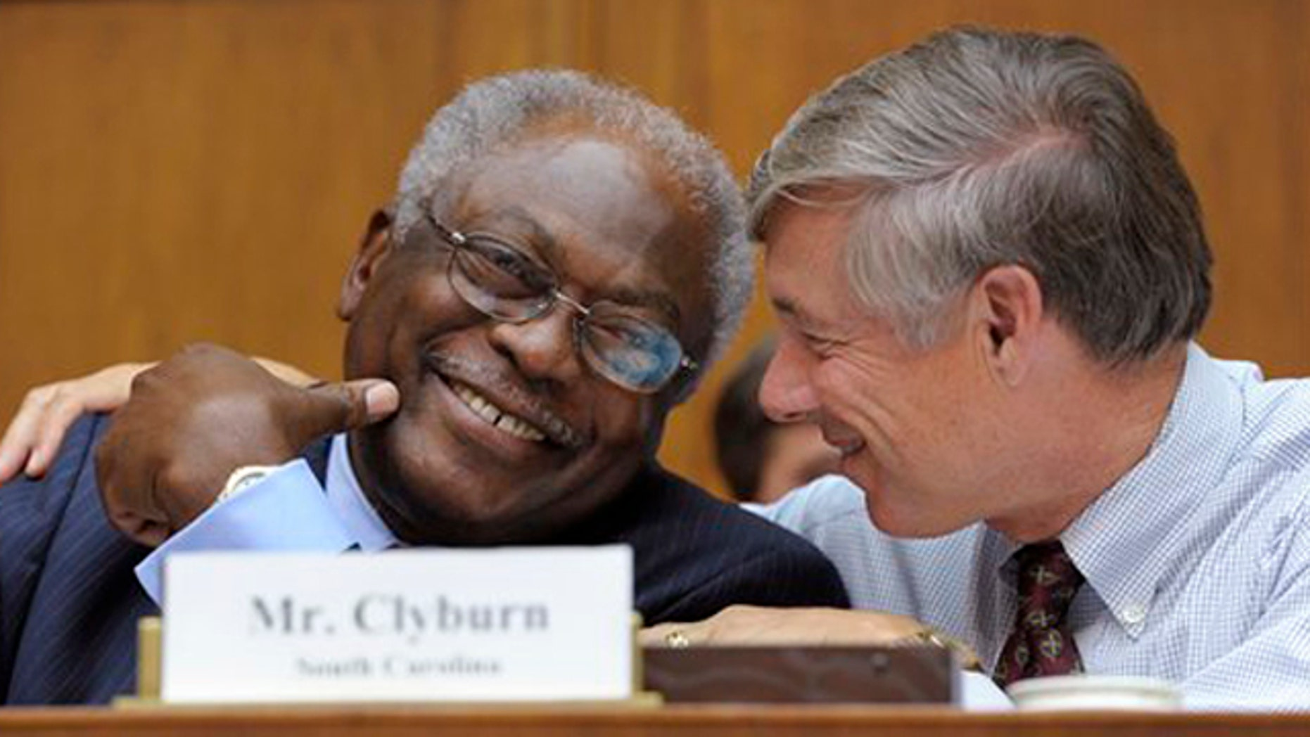 Rep. James Clyburn, left, shares a laugh with Rep. Fred Upton, right, before the start of the Joint Select Committee on Deficit Reduction meeting in Washington Sept. 8.