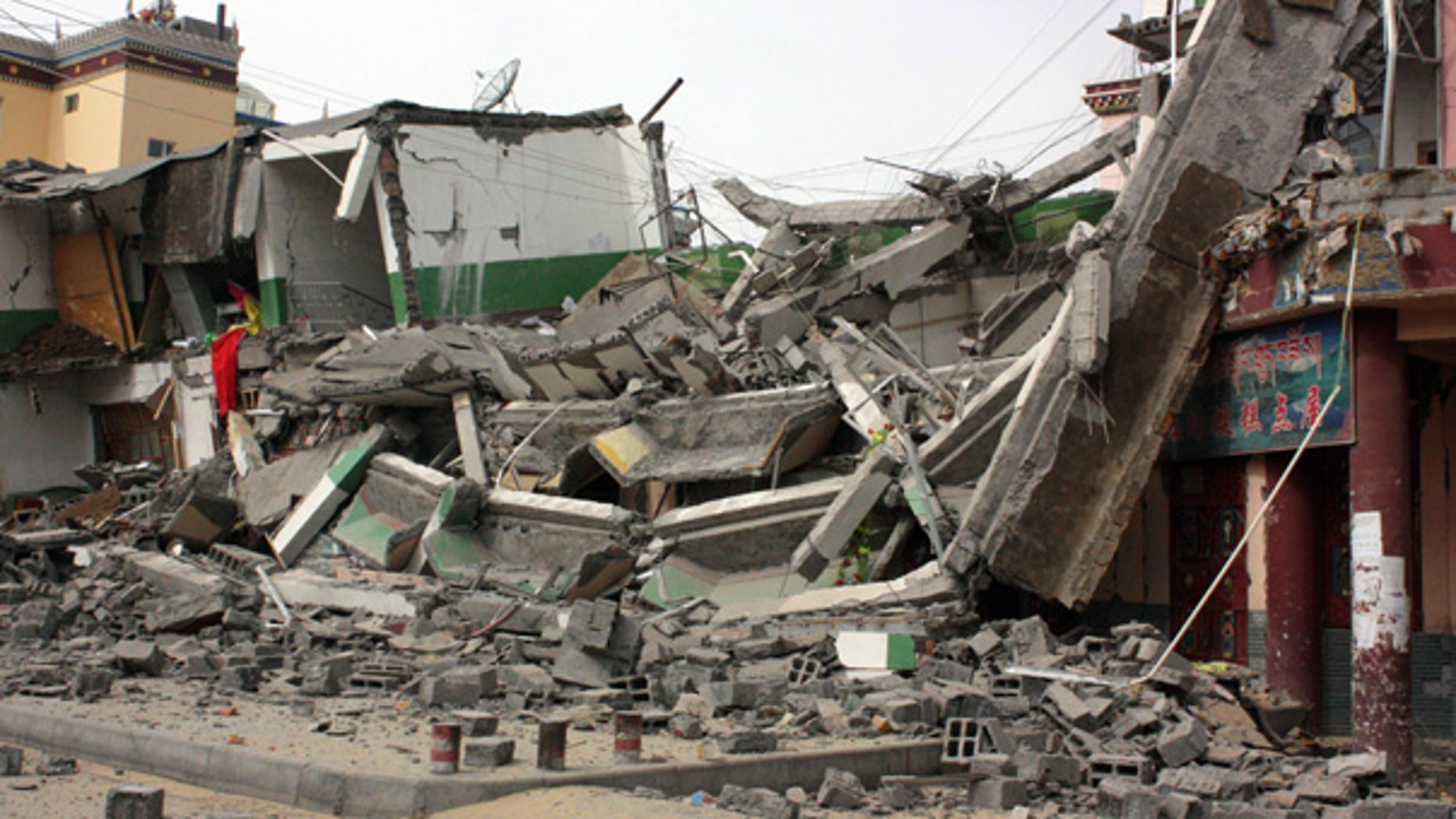 Apr. 14: A building is destroyed by the earthquake in Jiegu Town, western Qinghai Province, China.