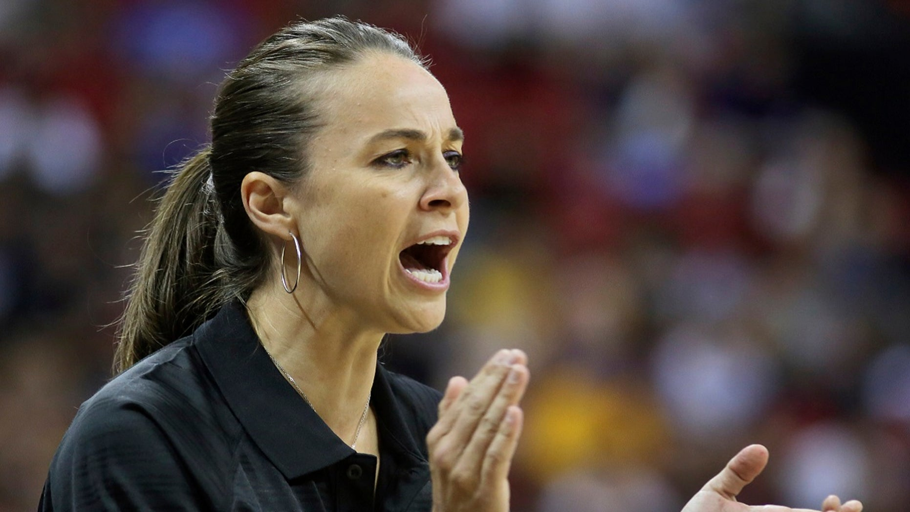 Becky Hammon coaches the San Antonio Spurs during an NBA summer league basketball game against the New York Knicks in Las Vegas,  July 11, 2015.