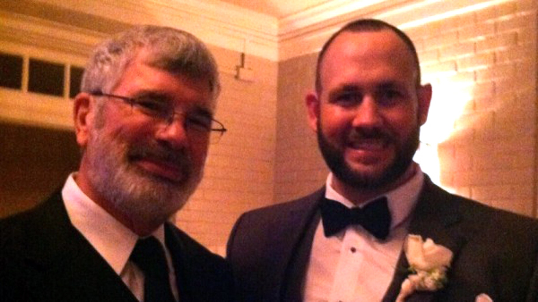 Coach McWilliams, left, pictured with Coach Beeler at his wedding.