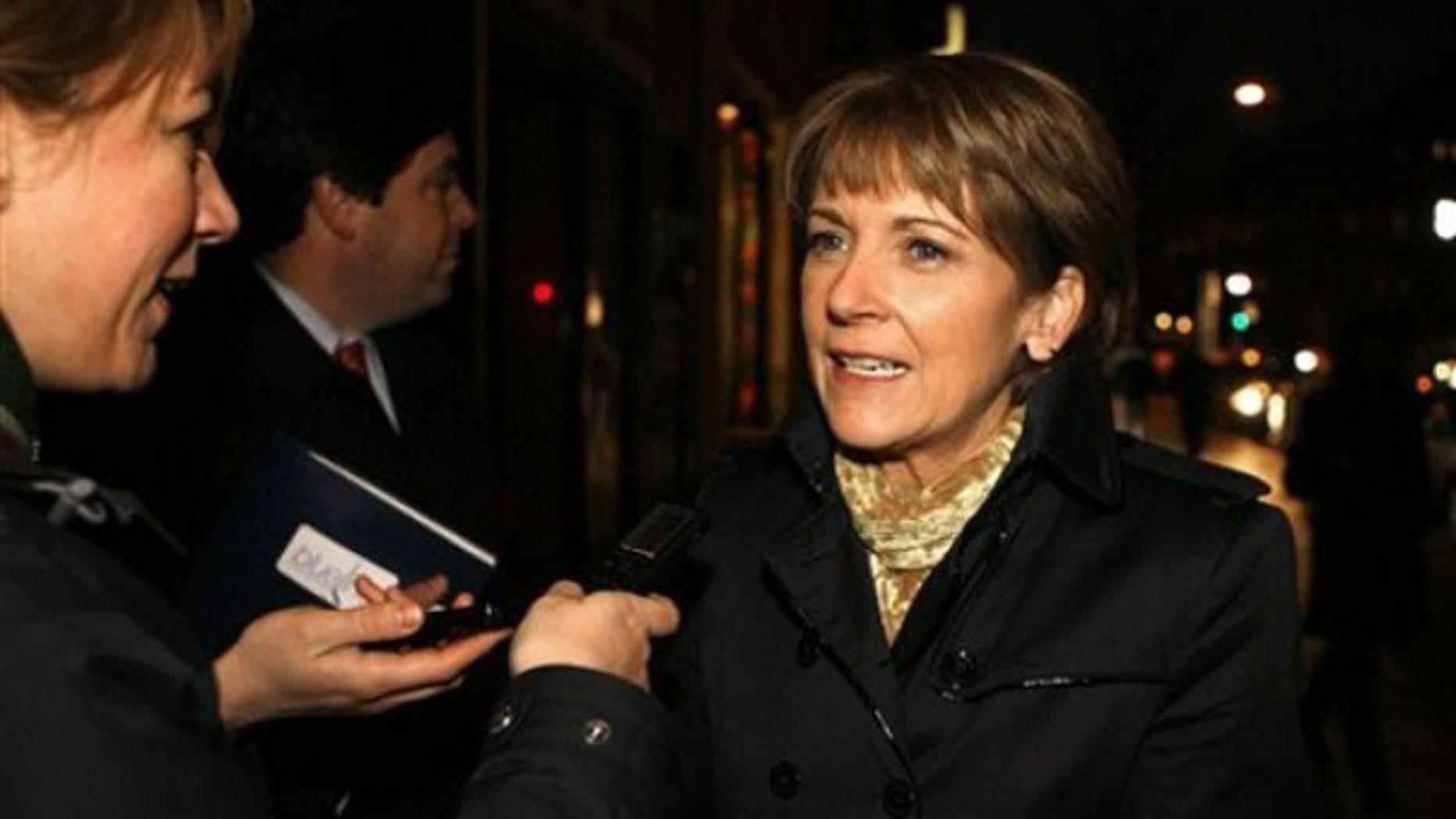 Democrat Martha Coakley speaks with reporters as she arrives at a fundraiser in Washington Jan. 12. (AP Photo)