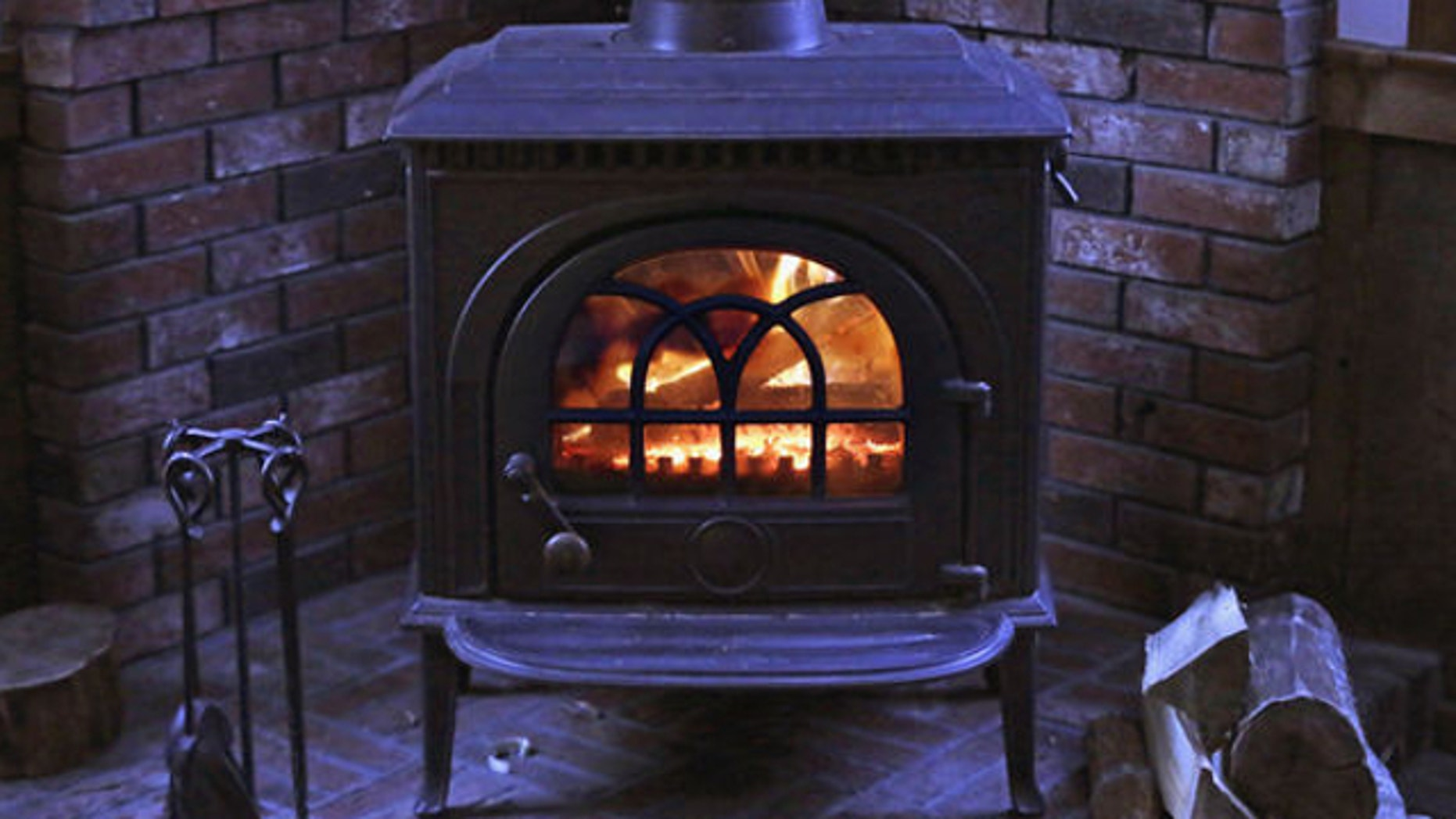 FILE: March 8, 2014: A wood stove heats a home in Freeport, Maine.