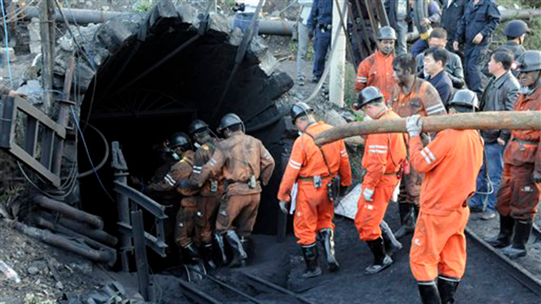 Rescue workers descend into the coal mine where a gas leak in the morning killed 20 miners and trapped another 23 in Shizong county in southwest China's Yunnan province Thursday Nov. 10, 2011.