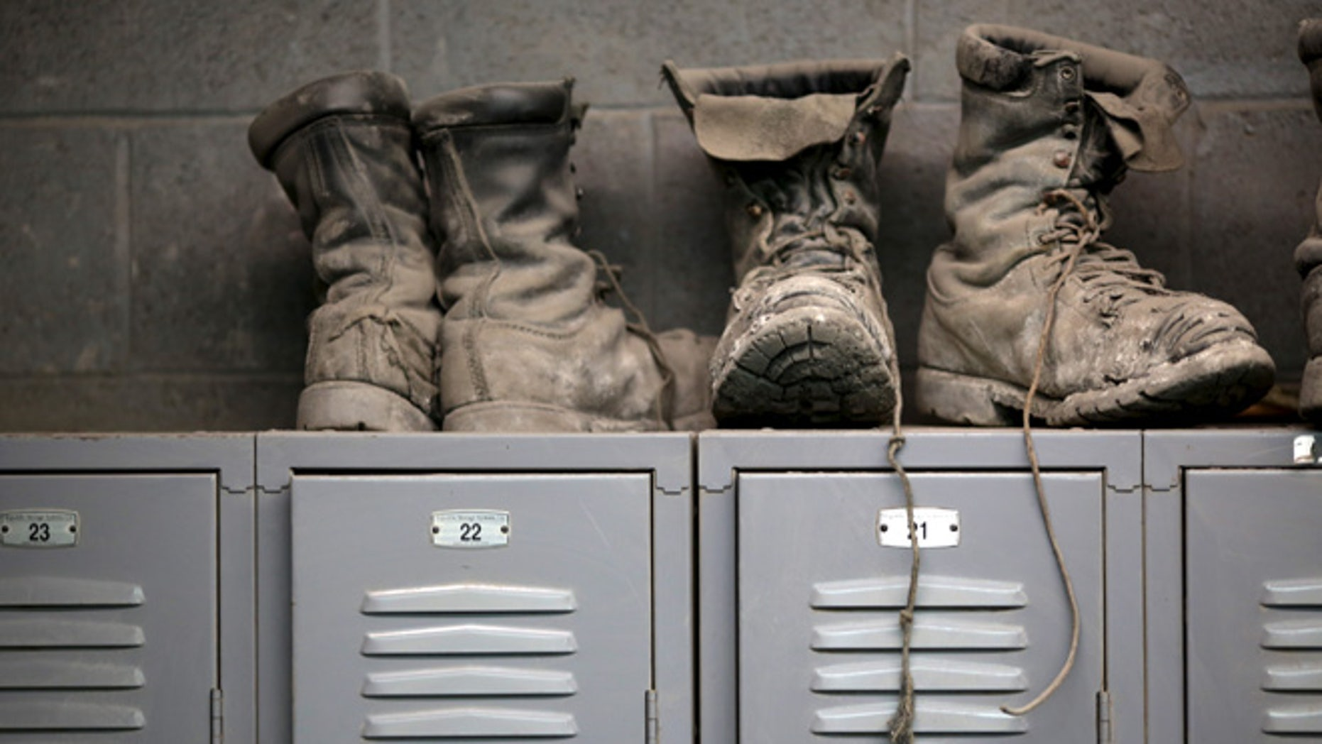 FILE 2014: Coal mining boots are shown above miners' lockers before the start of an afternoon shift near Gilbert, West Virginia.