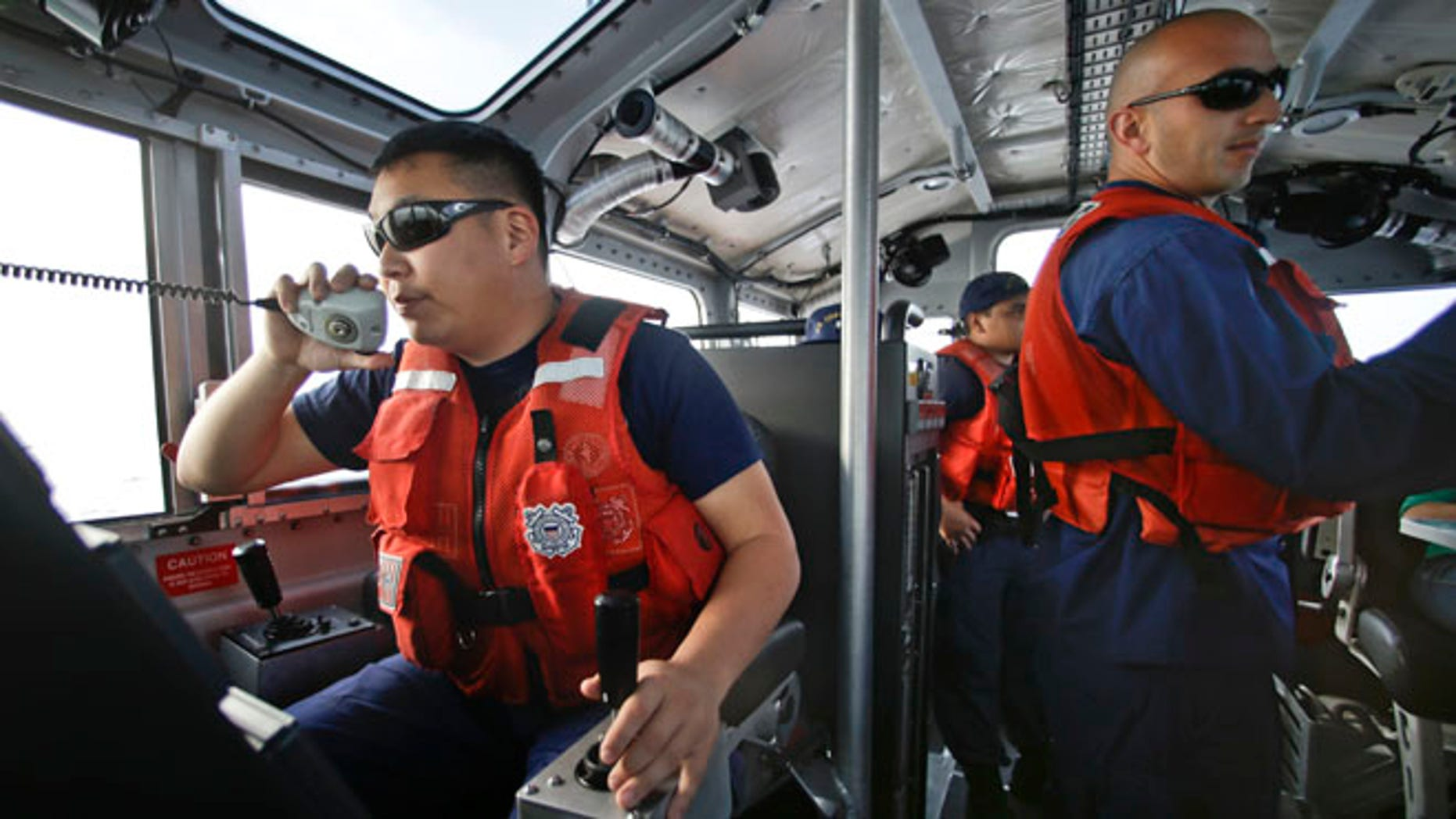 Jan. 28, 2014: Coast Guard officer William Pless communicates on the radio while steering the 45 foot Coast Guard vessel through a dense fog during a patrol off the San Diego coast in San Diego. With the drug war locking down land routes across Latin America and at the U.S. border, smugglers have been increasingly using large vessels to carry multi-ton loads of cocaine and marijuana hundreds of miles offshore, where the lead federal agency with extensive law enforcement powers is the Coast Guard, a military service roughly the size of the New York Police Department.