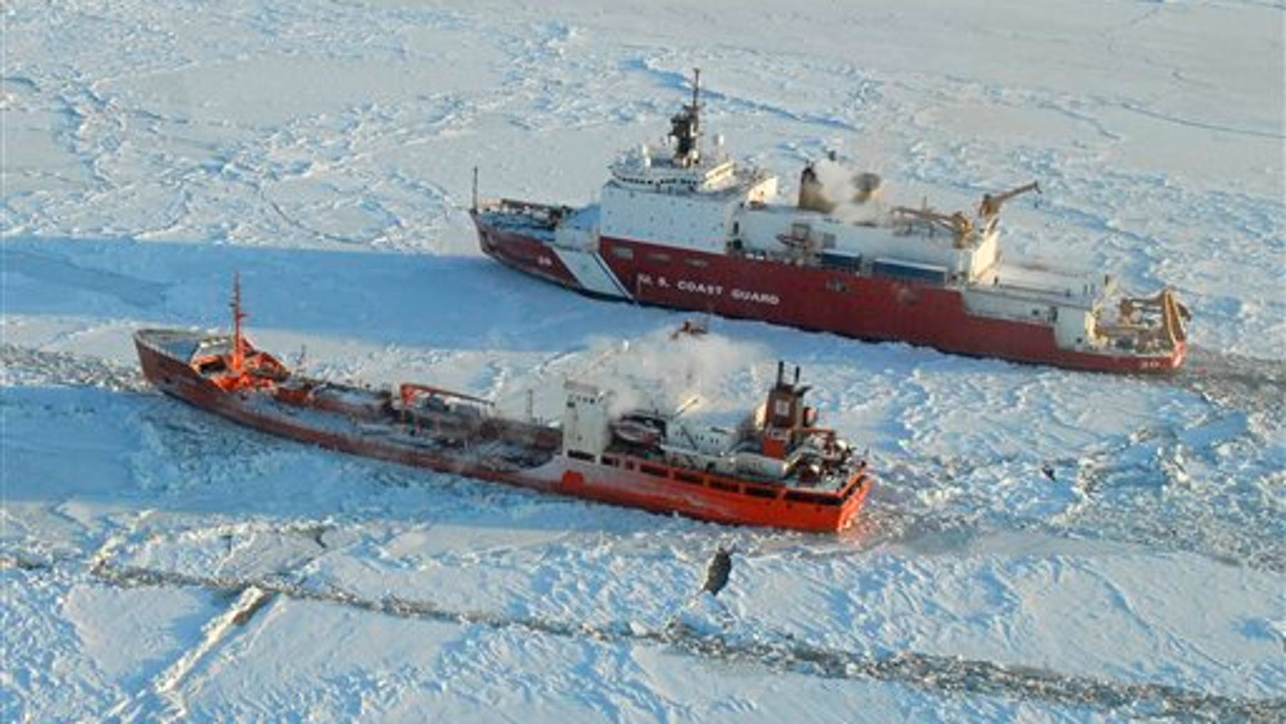 Jan. 6, 2012: The Coast Guard Cutter Healy breaks ice around the Russian-flagged tanker Renda 250 miles south of Nome. The Healy is the Coast Guard's only currently operating polar icebreaker. The vessels are transiting through ice up to five-feet thick in this area. The 370-foot tanker Renda will have to go through more than 300 miles of sea ice to get to Nome, a city of about 3,500 people on the western Alaska coastline that did not get its last pre-winter fuel delivery because of a massive storm.