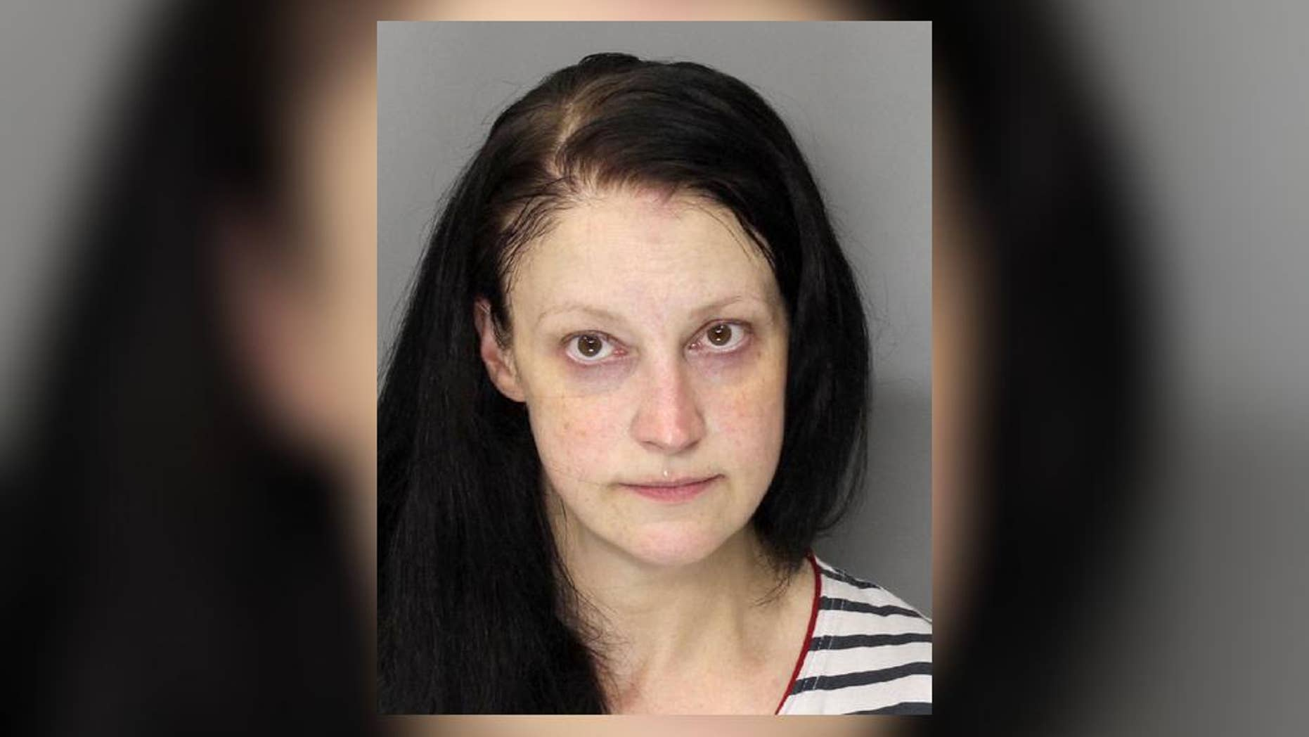 Carol June Sautter is in custody after allegedly placing her dead newborn in a freezer, Georgia police say.
