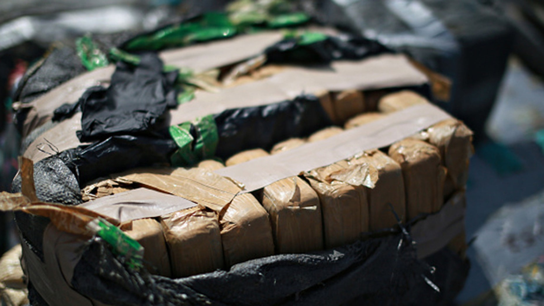 SAN DIEGO, CA - OCTOBER 6:  Piles of confiscated cocaine, seized during a 18 different interdictions off the coast of Central and South America, is prepared to be offloaded from aboard the Cutter Boutwell at Naval Base San Diego on October 6, 2014 in San Diego, California. Operation Martillo offloaded more than 28,000 pounds of cocaine with a value of $423 million dollars wholesale.  (Photo by Sandy Huffaker/Getty Images)