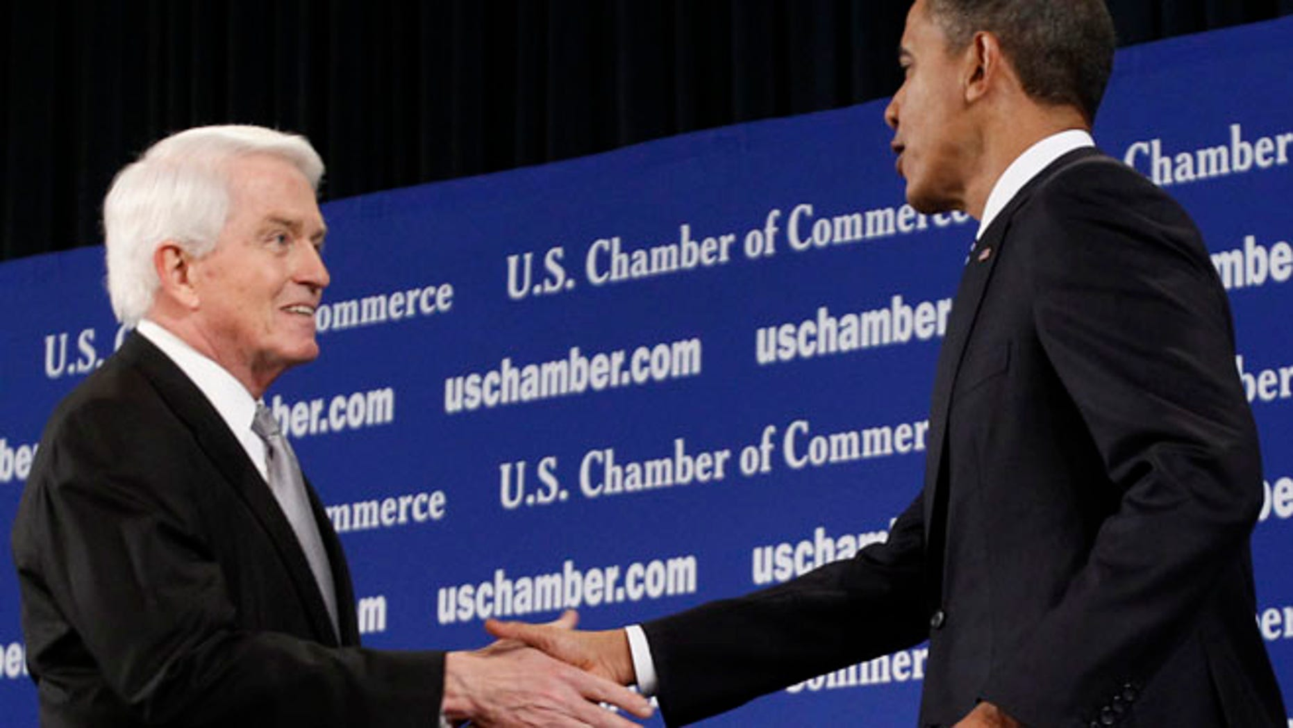 Feb 7. 2011: President Obama is greeted by Chamber of Commerce President Tom Donohue as he arrives to address the crowd in Washington. (Reuters)